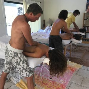 Couples Massage Class in Kona - guys working on their partners